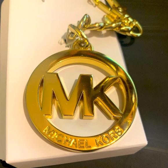 Michael Kors gold purse charm
